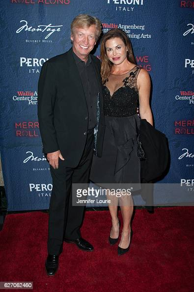 Director Nigel Lythgoe and Stephanie Magid arrive at the Opening Night of 'Merrily We Roll Along' at the Wallis Annenberg Center for the Performing...