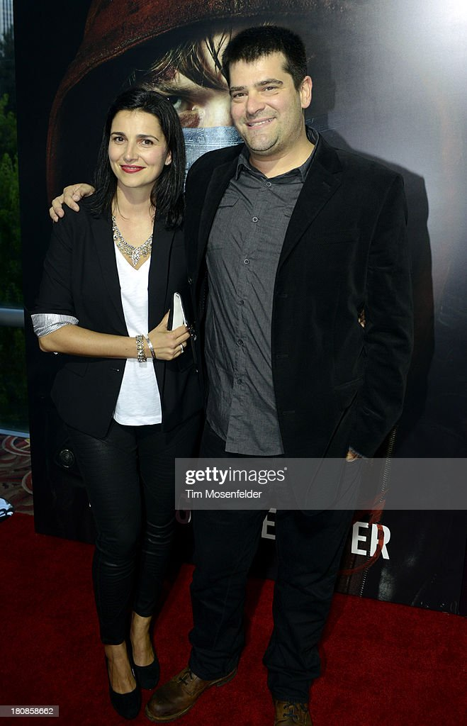 Director Nimrod Antal and Wife attend the US Premiere of Metallica Through The Never at the AMC Metreon on September 16 2013 in San Francisco...