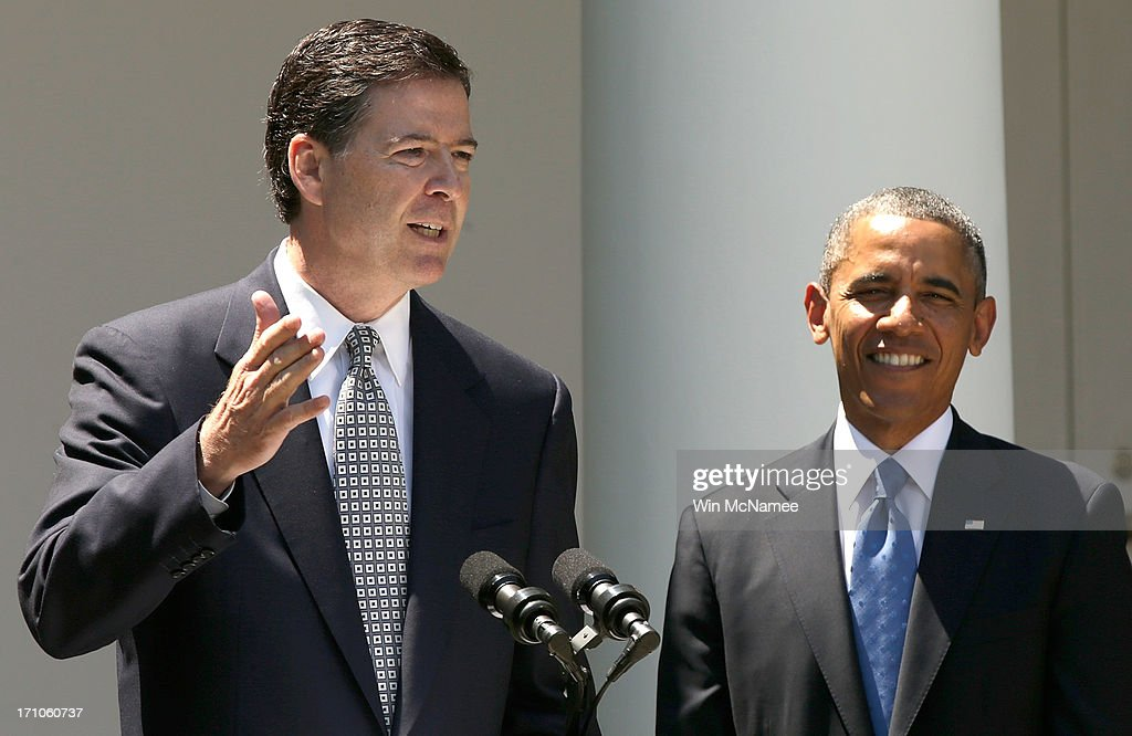 Director nominee James Comey (L) speaks as U.S. President <a gi-track='captionPersonalityLinkClicked' href=/galleries/search?phrase=Barack+Obama&family=editorial&specificpeople=203260 ng-click='$event.stopPropagation()'>Barack Obama</a> (R) looks on during a ceremony announcing Comey's nomination in the Rose Garden of the White House June 21, 2013 in Washington, DC. Comey is a former Justice Department official in the administration of former U.S. President George W. Bush.