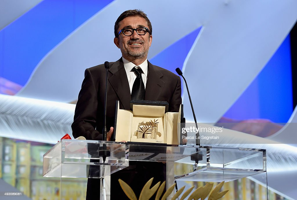 Director Nuri Bilge Ceylan poses on stage with the Palme d'Or for his film 'Winter's Sleeps' during the Closing Ceremony at the 67th Annual Cannes...