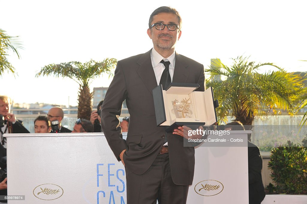 Director Nuri Bilge Ceylan poses with the Palme d'Or for his film 'Winter's Sleeps' at the Winners photocall during 67th Cannes Film Festival