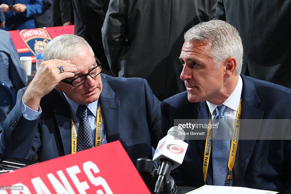 Director of Amateur Scouting Tony MacDonald (L) and general manager of the Carolina Hurricanes <a gi-track='captionPersonalityLinkClicked' href=/galleries/search?phrase=Ron+Francis&family=editorial&specificpeople=202889 ng-click='$event.stopPropagation()'>Ron Francis</a> look on prior to round one of the 2016 NHL Draft on June 24, 2016 in Buffalo, New York.