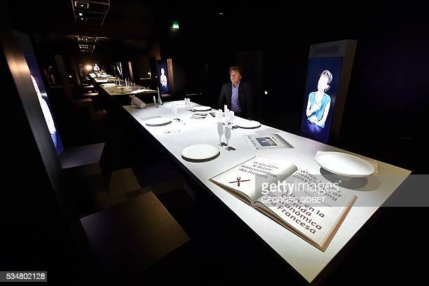 Director of Bordeaux's wine museum Philippe Massol gives explanation about the electronic table in one of the exhibition room of the new structure in...