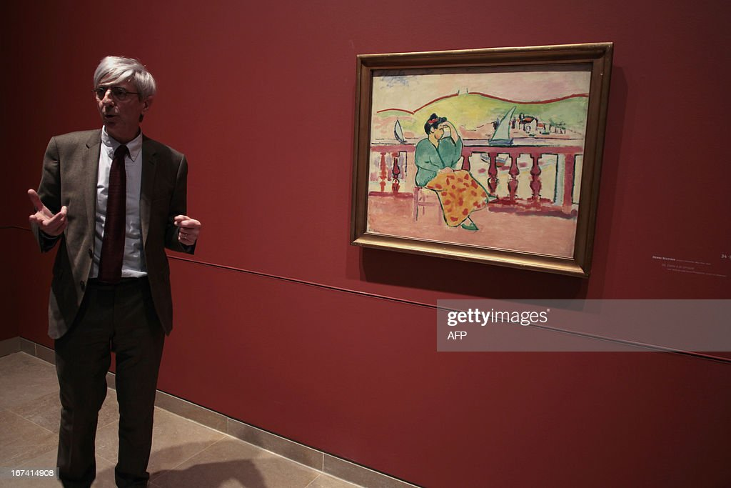 Director of Caen's fine arts museum, Patrick Ramade (L) looks at the painting 'Dame à la terrasse' by Henri Matisse, three days before the opening of 'Normandie Impressionniste' at Caen's fine arts museum, on April 24, 2013. The exhibition which takes place in Caen is one of the three most important, with the ones of Le Havre and Rouen, which are 'National interest' labelized. Caen's exhibition gathers 67 art paintings including 34 from abroad. This exhibition (in Rouen, Caen and Le Havre) begins on April 27 to September 29.