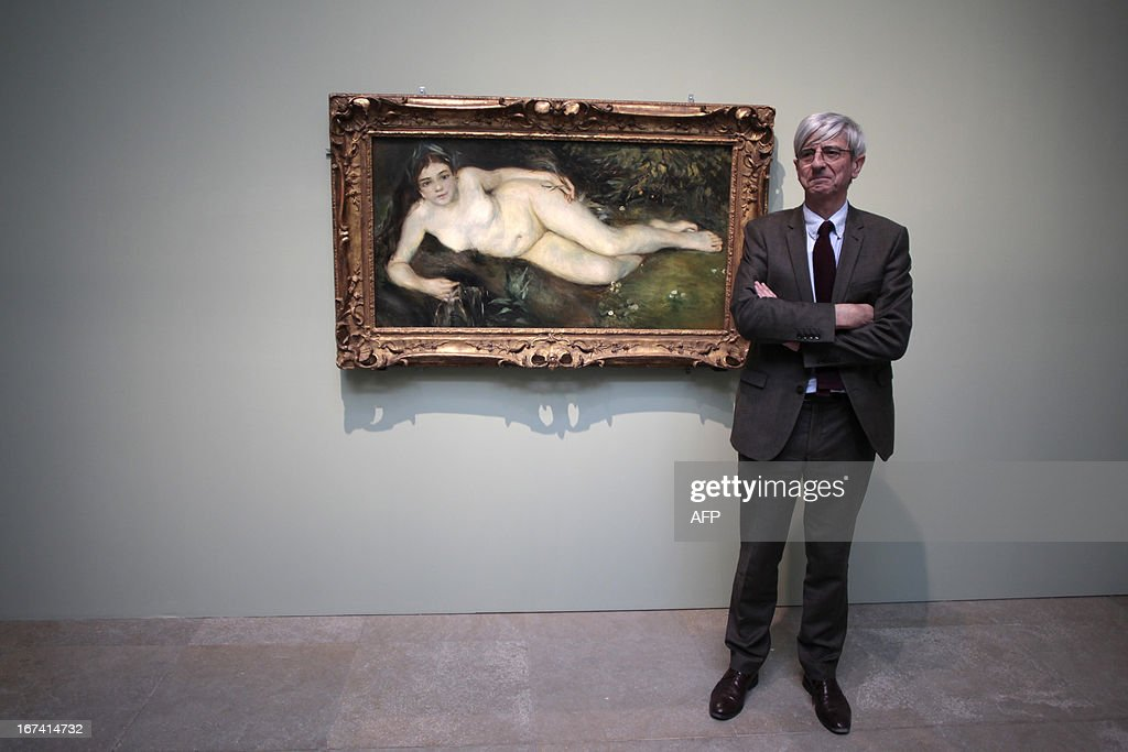 Director of Caen's fine arts museum, Patrick Ramade stands by the painting 'Nymphe à la source' by Pierre-Auguste Renoir, three days before the opening of 'Normandie Impressionniste' at Caen's fine arts museum, on April 24, 2013. The exhibition which takes place in Caen is one of the three most important, with the ones of Le Havre and Rouen, which are 'National interest' labelized. Caen's exhibition gathers 67 art paintings including 34 from abroad. This exhibition (in Rouen, Caen and Le Havre) begins on April 27 to September 29.
