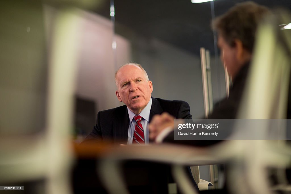 Director of Central Intelligence Agency John Brennan (center) with a CIA press officer before an interview for 'The Spymasters,' a CBS/Showtime documentary on CIA directors, Washington, DC, May 16, 2015.
