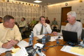 Director of college scouting John Dorsey Head Coach Mike McCarthy General Manager Ted Thompson in the Packers war room during the late first round of...