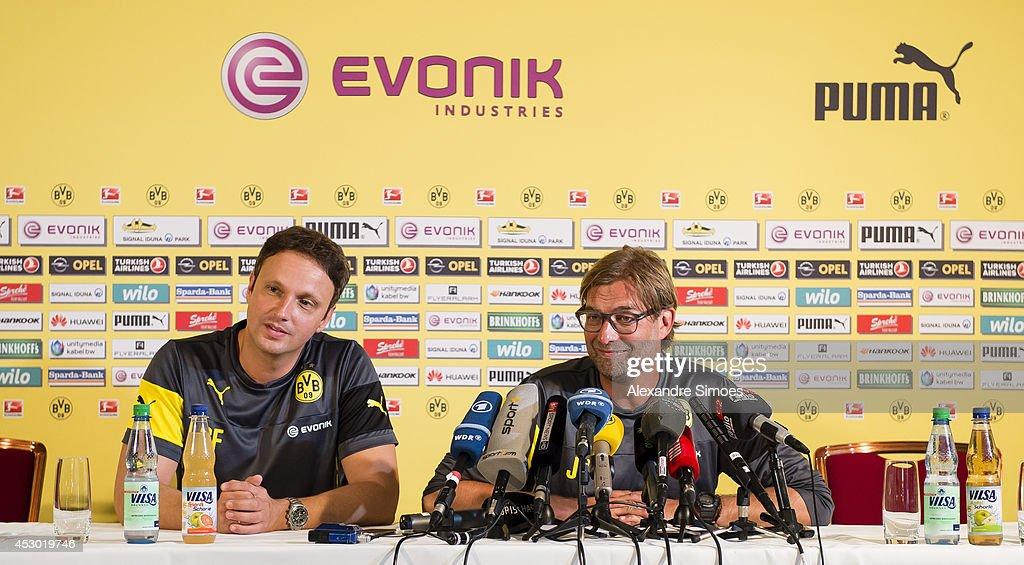 Director of Communication Sasha Fligge of Borussia Dortmund (L) and Head coach Juergen Klopp (BVB) of Borussia Dortmund attends a press conference on August 1, 2014 in Bad Ragaz, Switzerland.