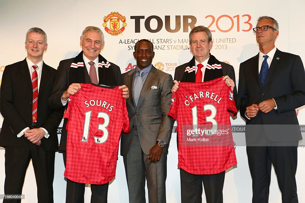 Director of Communications from Manchester United Phil Townsend, George Souris MP, Dwight Yorke, NSW Premier Barry O'Farrell and FFA CEO David Gallop pose after a press conference at Museum of Contemporary Art on December 10, 2012 in Sydney, Australia. Manchester United will play an A-League All-Stars match in Sydney on July 20, 2013.