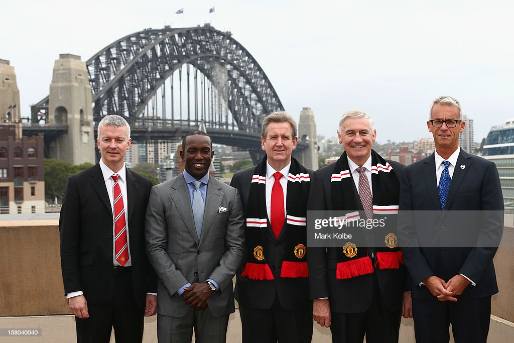 Director of Communications from Manchester United Phil Townsend, <a gi-track='captionPersonalityLinkClicked' href=/galleries/search?phrase=Dwight+Yorke&family=editorial&specificpeople=206855 ng-click='$event.stopPropagation()'>Dwight Yorke</a>, NSW Premier Barry O'Farrell, George Souris MP and FFA CEO <a gi-track='captionPersonalityLinkClicked' href=/galleries/search?phrase=David+Gallop&family=editorial&specificpeople=579322 ng-click='$event.stopPropagation()'>David Gallop</a> pose after a press conference at Museum of Contemporary Art on December 10, 2012 in Sydney, Australia. Manchester United will play an A-League All-Stars match in Sydney on July 20, 2013.