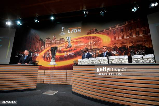 UEFA director of competitions Giorgio Marchetti French former international Eric Abidal and UEFA head of club competitions Michael Heselschwerdt take...