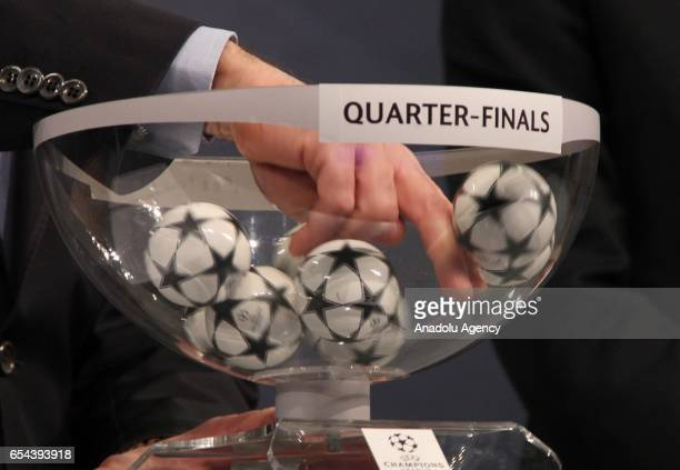 UEFA director of competitions Giorgio Marchetti prepares to make a selection during the quarterfinal draw of the UEFA Champions League 2016/17 at the...