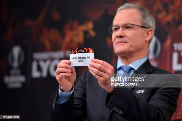 UEFA director of competitions Giorgio Marchetti shows the slip of AEK Athens during the draw for the round of 32 of the UEFA Europa League football...