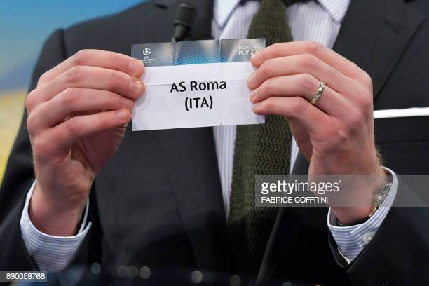 UEFA director of competitions Giorgio Marchetti shows the slip of as AS Roma during the draw for the round of 16 of the UEFA Champions League...