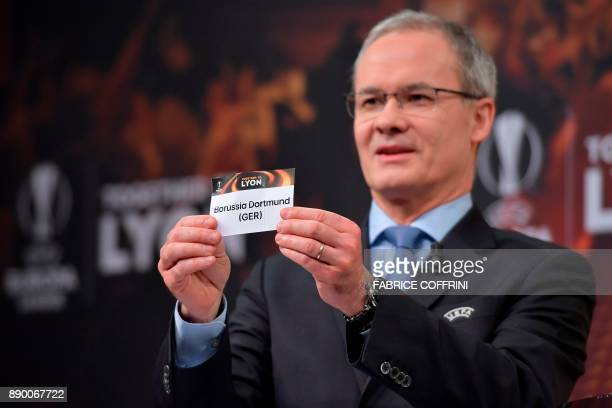UEFA director of competitions Giorgio Marchetti shows the slip of Borussia Dortmund during the draw for the round of 32 of the UEFA Europa League...