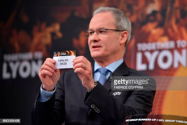UEFA director of competitions Giorgio Marchetti shows the slip of Celtic FC during the draw for the round of 32 of the UEFA Europa League football...