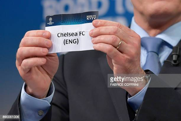 UEFA director of competitions Giorgio Marchetti shows the slip of Chelsea FC during the draw for the round of 16 of the UEFA Champions League...