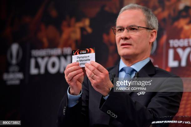 UEFA director of competitions Giorgio Marchetti shows the slip of Olympique de Marseille during the draw for the round of 32 of the UEFA Europa...