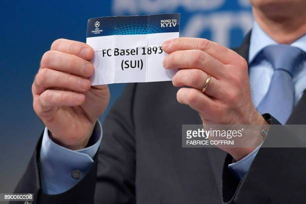 UEFA director of competitions Giorgio Marchetti shows the slip of FC Basel during the draw for the round of 16 of the UEFA Champions League football...