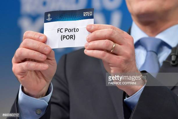 UEFA director of competitions Giorgio Marchetti shows the slip of FC Porto during the draw for the round of 16 of the UEFA Champions League football...
