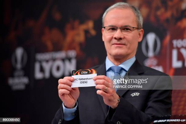 UEFA director of competitions Giorgio Marchetti shows the slip of FC Copenhagen during the draw for the round of 32 of the UEFA Europa League...