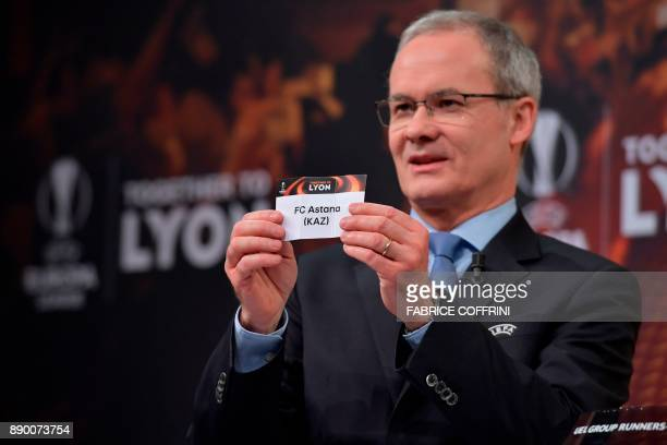 UEFA director of competitions Giorgio Marchetti shows the slip of FC Astana during the draw for the round of 32 of the UEFA Europa League football...