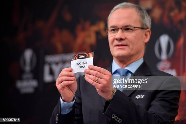 UEFA director of competitions Giorgio Marchetti shows the slip of OGC Nice during the draw for the round of 32 of the UEFA Europa League football...