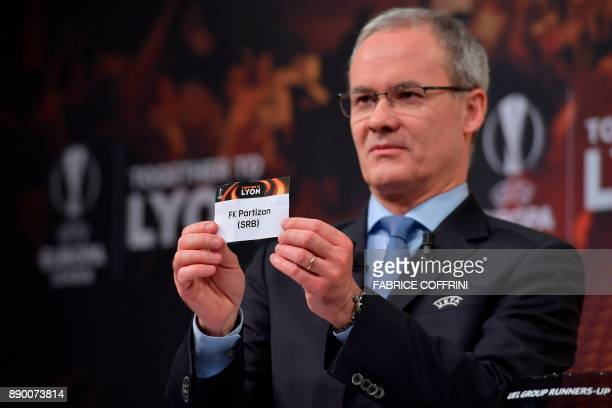 UEFA director of competitions Giorgio Marchetti shows the slip of Partizan Belgrade during the draw for the round of 32 of the UEFA Europa League...
