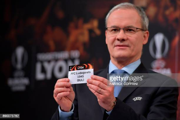 UEFA director of competitions Giorgio Marchetti shows the slip of Ludogorets Razgrad during the draw for the round of 32 of the UEFA Europa League...