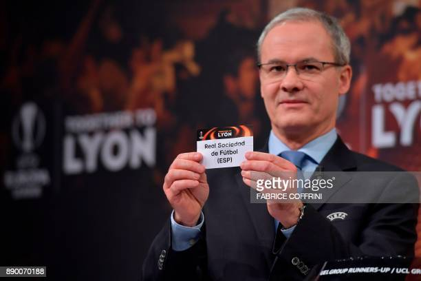 UEFA director of competitions Giorgio Marchetti shows the slip of Real Sociedad during the draw for the round of 32 of the UEFA Europa League...