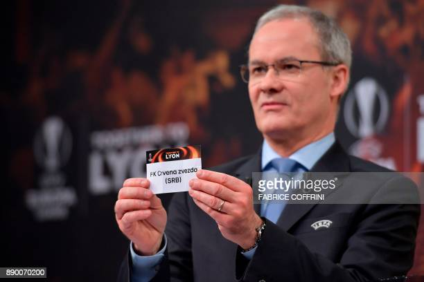 UEFA director of competitions Giorgio Marchetti shows the slip of Red Star Belgrade during the draw for the round of 32 of the UEFA Europa League...