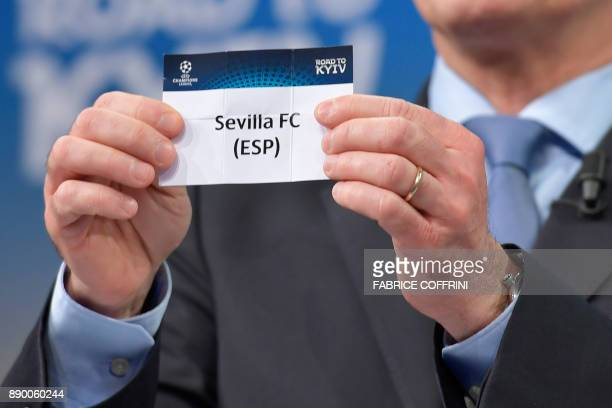 UEFA director of competitions Giorgio Marchetti shows the slip of Sevilla FC during the draw for the round of 16 of the UEFA Champions League...