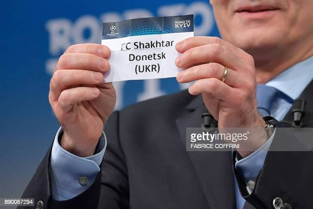 UEFA director of competitions Giorgio Marchetti shows the slip of Shakhtar Donetsk during the draw for the round of 16 of the UEFA Champions League...