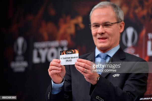 UEFA director of competitions Giorgio Marchetti shows the slip of Spartak Moscow during the draw for the round of 32 of the UEFA Europa League...