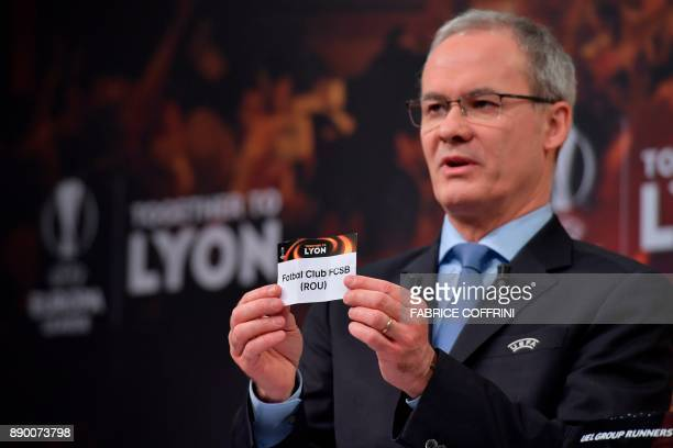 UEFA director of competitions Giorgio Marchetti shows the slip of Steaua Bucarest during the draw for the round of 32 of the UEFA Europa League...