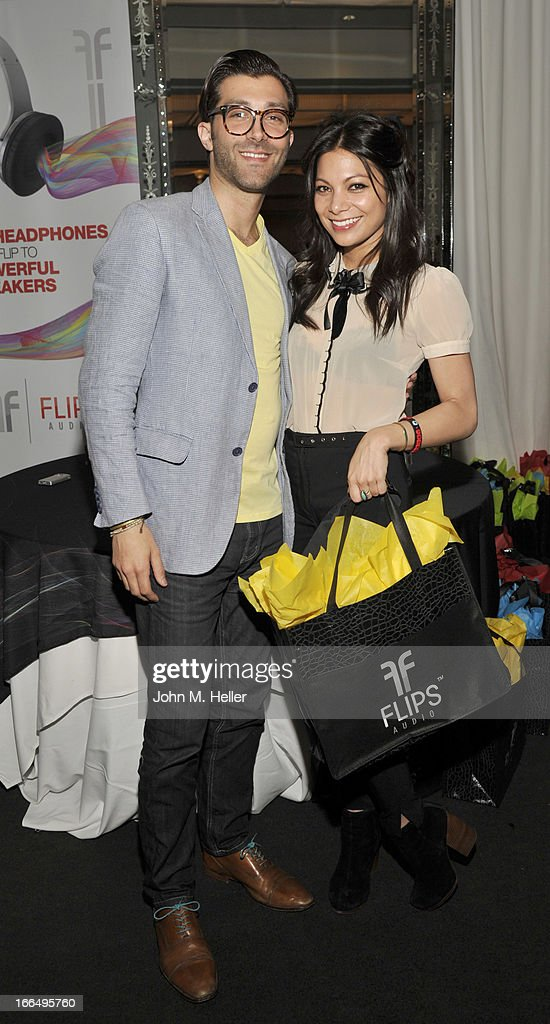 Director Of Creative & Digital Strategy Flips Audio Nunzio Esposito and actress Ginger Gonzoga attend the Flips Audio MTV Awards Secret Room gifting suite at the SLS Hotel on April 12, 2013 in Beverly Hills, California.