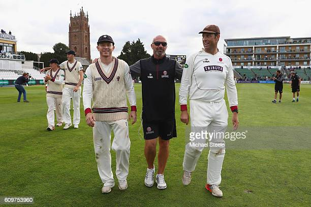 Director of cricket of Somerset Matthew Maynard alongside captain Chris Rogers and Marcus Trescothick during a lap of honour concluding their sides...