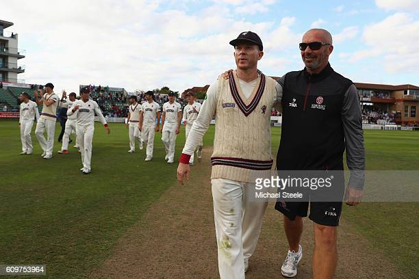 Director of cricket of Somerset Matthew Maynard alongside captain Chris Rogers during a lap of honour concluding their sides 325 run victory during...