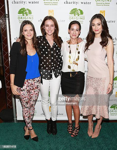 Director of design and branding for charity water Viktoria Harrison and actress Jessica Stroup pose with hosts Global President/General manager of...