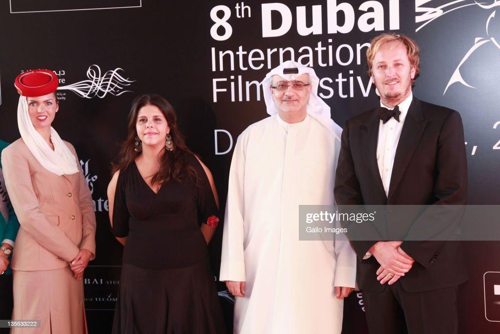 Director of DIFF Masoud Amralla Al Ali and director James Bobin (C) attend 'The Muppets' premiere during the Dubai International Film Festival - Day Three on Decmeber 9, 2011 in Dubai.