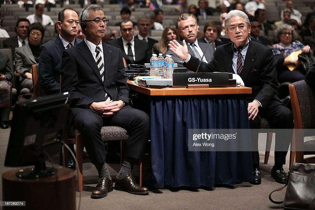Director of General Affairs and Risk Management of GS-Yuasa Masahide Kuragaki (R) speaks as General Manager of the Special Battery Technical Department of Special Battery & Lithium-ion Battery Division of GS-Yuasa Yoshiaki Namikawa (2nd L) listens during an investigative hearing into the Boeing 787 battery fire before the National Transportation Safety Board April 23, 2013 in Washington, DC. The NTSB held a two-day hearing to investigate the design, testing, certification and operation of the lithium-ion battery on the Boeing 787 and the battery fire incident.