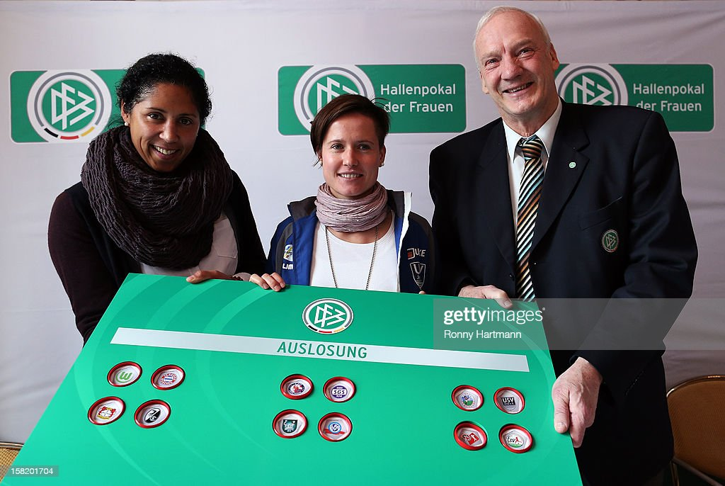 Director of German Football Association (DFB) <a gi-track='captionPersonalityLinkClicked' href=/galleries/search?phrase=Steffi+Jones+-+Soccer+Player&family=editorial&specificpeople=226998 ng-click='$event.stopPropagation()'>Steffi Jones</a> (L-R), DFB honorary vice president <a gi-track='captionPersonalityLinkClicked' href=/galleries/search?phrase=Hans-Georg+Moldenhauer&family=editorial&specificpeople=2380283 ng-click='$event.stopPropagation()'>Hans-Georg Moldenhauer</a> and Kathleen Radtke of FF USV Jena attend the DFB Women's Indoor Trophy Draw Ceremony on December 11, 2012 in Magdeburg, Germany.