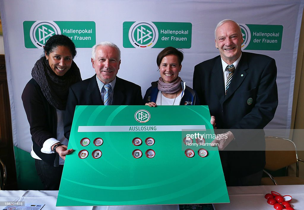 Director of German Football Association (DFB) <a gi-track='captionPersonalityLinkClicked' href=/galleries/search?phrase=Steffi+Jones+-+Fotbollsspelare&family=editorial&specificpeople=226998 ng-click='$event.stopPropagation()'>Steffi Jones</a> (L-R), Erwin Bugar, president of the Saxony-Anhalt Football Association, Kathleen Radtke of FF USV Jena and DFB honorary vice president <a gi-track='captionPersonalityLinkClicked' href=/galleries/search?phrase=Hans-Georg+Moldenhauer&family=editorial&specificpeople=2380283 ng-click='$event.stopPropagation()'>Hans-Georg Moldenhauer</a> attend the DFB Women's Indoor Trophy Draw Ceremony on December 11, 2012 in Magdeburg, Germany.