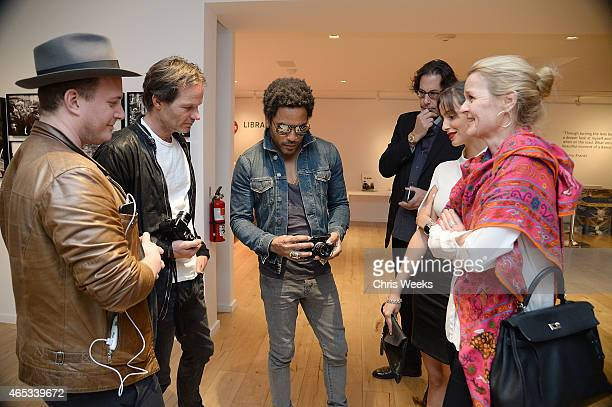 Director of Global Sales Leica Camera AG Steffen Keil music recording artist Lenny Kravitz and Art Director of the Global Leica Gallery Network Karin...