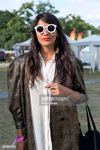 Director of Haus of Artisans Susan Katerine Rozo Arias wears a vintage jacket and dress on day 2 of the Wilderness Festival in Cornbury Park on...