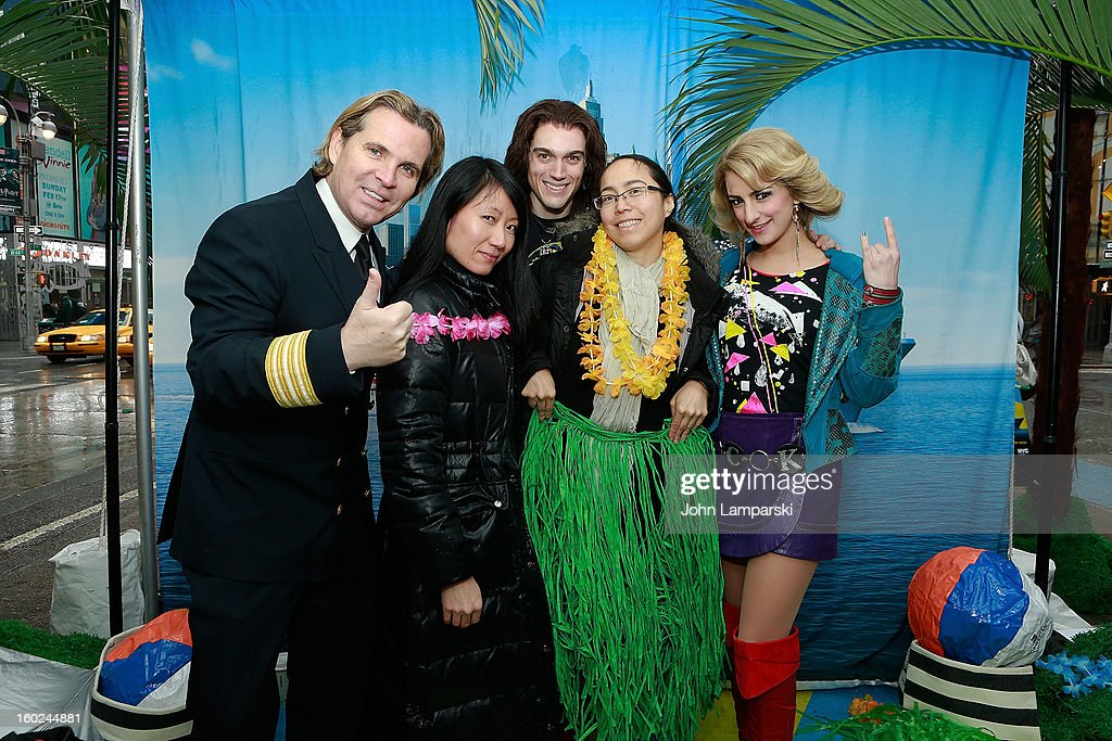 Director of Hotel Operations Klaus Lugmaier, Actors Justin Matthew Sargent,Tessa Alves of rock of Ages and contest winners attend the Norwegian Warming Station launch in Times Square on January 28, 2013 in New York City.