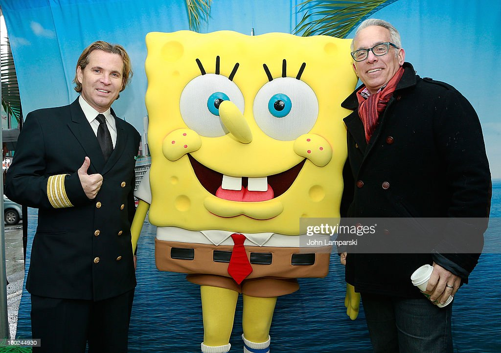 Director of Hotel Operations Klaus Lugmaier, SpongeBob SquarePants and Chef Geoffrey Zakarian attend the Norwegian Warming Station launch in Times Square on January 28, 2013 in New York City.