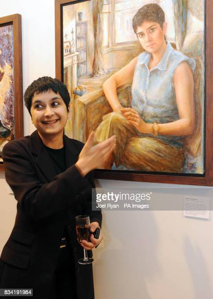 Director of Human Rights group Liberty Shami Chakrabati stands in front of her self portrait at the 'First Direct 50 Women Of Substance' photo...