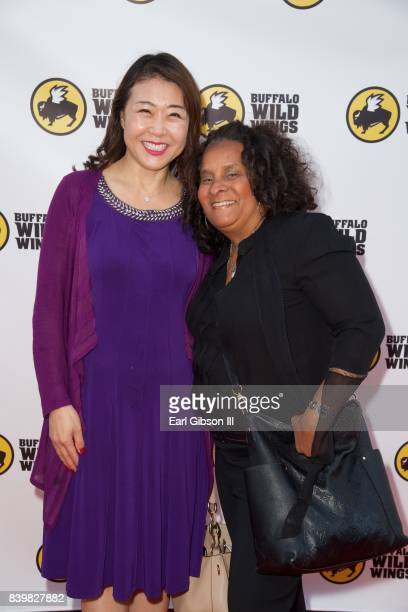Director of Korean Churces for Community Development Hyepin Im and Director of Brotherhood Crusade Charisse Bremond attend the Buffalo Wild Wings...