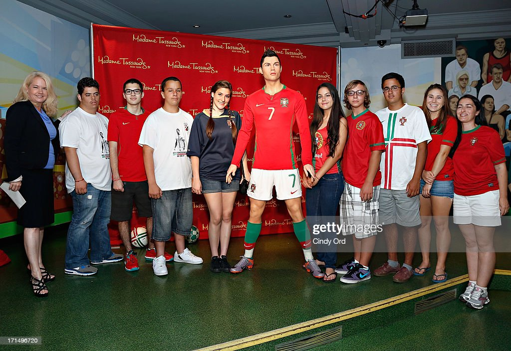 Director of Marketing at Madame Tussauds NY Stacy MacGregor, Students from Escola Lusitania - Portuguese School of the Portuguese Club of Long Branch and their teacher Raquel Rosa (R) attend as Madame Tussauds New York launches the Cristiano Ronaldo (C) wax figure on June 25, 2013 in New York City.